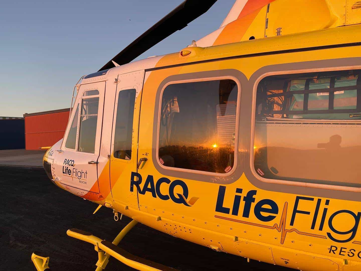 Two boaties rescued from beach after boat takes on water